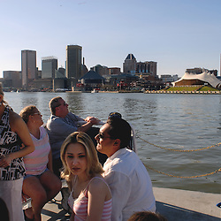 Passengers on a Baltimore water taxi take in the sights around the Inner Harbor...Photo by Susana Raab