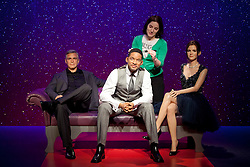 © Licensed to London News Pictures. 22/05/2013. London, UK. Wardrobe assistant, Luisa Compobassi adjusts the hair on a waxwork figure of rapper, actor and producer Will Smith after he was placed on a sofa alongside actor George Clooney (L) and Harry Potter actress Emma Watson. The former Fresh Prince of Bel Air star today (22/05/2013) took his place in Madame Tussauds 'A-List' party in London. Photo credit: Matt Cetti-Roberts/LNP