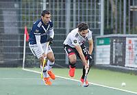 AMSTELVEEN - Tanguy Cosyns (Amsterdam)  met Martin Ferreiro (Pinoke)    tijdens   hoofdklasse hockeywedstrijd mannen,  AMSTERDAM-PINOKE (1-3) , die vanwege het heersende coronavirus zonder toeschouwers werd gespeeld. COPYRIGHT KOEN SUYK