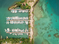 Aerial view of a small harbour in Vai'are on Moorea island in French Polynesia.