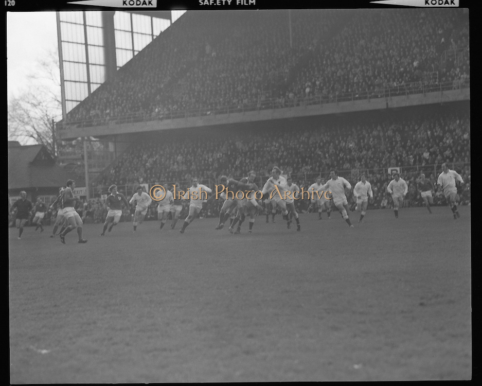 Ireland Vs England at Lansdowne Rd..1971..13.02.1971..02.13.1971..13th February 1971..In the Five Nations Championship, Ireland took on England at Lansdowne Road,Dublin. The final score in the game was Ireland 6,England 9..Bob Hiller,the England fullback,scored all his teams points with three penalties..Ireland replied with two tries from Grant and Duggan..In the championship,Wales won the Triple Crown and completed the Grand Slam when they defeated France in their final game of the season..Picture of a packed stand as the crowd wait in anticipation as Ireland defenders attempt to break up an England attack.
