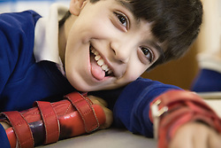 Pupil with physical disability wearing a handsplint