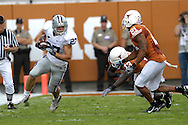September 29, 2007 - Austin, TX..Wide receiver Jordy Nelson #27 of the Kansas State Wildcats rushes up field against pressure from defenders Erick Jackson #21 and Ryan Palmer #13 of the Texas Longhorns, during a NCAA football game at Darrell Royal-Texas Memorial Stadium on September 29, 2007...FBC:  The Wildcats defeated the Longhorn 41-21.  .Photo by Peter G. Aiken/Cal Sport Media