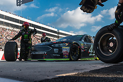 October 7, 2018 - Dover, DE, U.S. - DOVER, DE - OCTOBER 07: The crew of the The #41 Stewart-Haas Racing Ford driven by Kurt Busch go to work during a pit stop in the Gander Outdoors 400 on October 07, 2018, at Dover International Speedway in Dover, DE. (Photo by David Hahn/Icon Sportswire) (Credit Image: © David Hahn/Icon SMI via ZUMA Press)