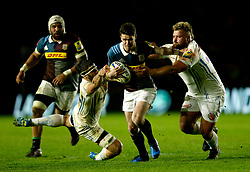 Harlequins' Tim Swiel (centre) breaks through Exeter's Tomas Francis and Don Armand (left) during the Aviva Premiership match at Twickenham Stoop, London.