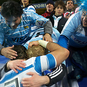 Juan Manuel Leguizamon, Argentina, is mobbed by fans after their teams 13-12 victory with fans during the Argentina V Scotland, Pool B match at the IRB Rugby World Cup tournament. Wellington Regional Stadium, Wellington, New Zealand, 25th September 2011. Photo Tim Clayton...