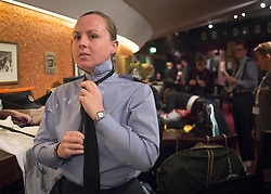 © Licensed to London News Pictures. 07/11/2015.  Royal Albert Hall, London, UK.  A member of the Royal Air Force (RAF) sorts out her tie before the annual Festival of Remembrance.   Photo credit : Alison Baskerville/LNP