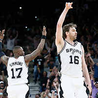 04 April 2017: San Antonio Spurs guard Jonathon Simmons (17) and San Antonio Spurs center Pau Gasol (16) celebrate during the San Antonio Spurs 95-89 OT victory over the Memphis Grizzlies, at the AT&T Center, San Antonio, Texas, USA.