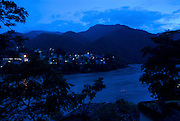 India, Uttarakhand, Rishikesh at night Ganges river in the foreground