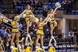 Dec 14, 2019; Morgantown, WV, USA; West Virginia Mountaineers cheerleaders perform during the second half against the Nicholls State Colonels at WVU Coliseum. Mandatory Credit: Ben Queen-USA TODAY Sports