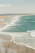 View of people relaxing on beach, Conil de la Frontera, Spain