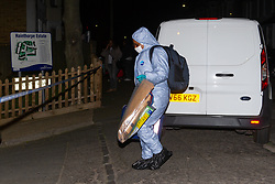 March 27, 2019 - London, London, United Kingdom - West Norwood shooting. ..A forensics officer arrives at the crime scene...A teenage boy has been shooted dead in Friar Mews, West Norwood (South London), this afternoon. Police were called at 4.11pm to reports of a young male in a critical condition and two men have been arrested. (Credit Image: © Gustavo Valiente/i-Images via ZUMA Press)