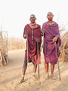 Portrait of two Maasai tribesmen with thier faces painted, Tipilit village near Amboseli National Park, Kenya
