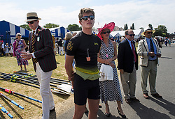 © Licensed to London News Pictures. 04/07/2018. Henley-on-Thames, UK. Family and friends of rowers watch as team enters the water on day one of the Henley Royal Regatta, set on the River Thames by the town of Henley-on-Thames in England. Established in 1839, the five day international rowing event, raced over a course of 2,112 meters (1 mile 550 yards), is considered an important part of the English social season. Photo credit: Ben Cawthra/LNP