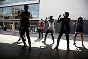 Street dance group practice their routine outside the Royal Festival Hall. The South Bank is a significant arts and entertainment district, and home to an endless list of activities for Londoners, visitors and tourists alike.