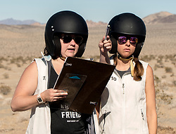 October 17, 2018 - Johnson Valley, California, U.S. - EMILY WINSLOW, left, and ALICIA FARRAR of Team Naviguessers on Day 5 of the third annual Rebelle Rally, the first women's off-road navigation rally in the United States. The event features a unique scoring system in which precise navigation - not speed - is the ultimate goal.  With cell phones and GPS devices banned during the 10-day event, and armed with just maps, compasses and roadbooks, 43 two-person teams are tasked with scoring points based on time, distance and hidden checkpoints as they make their way across 1,600 miles of scrub brush, sand dunes and boulders in the Nevada and California desert.(Credit Image: © Brian Cahn/ZUMA Wire)