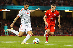 October 11, 2018 - Cardiff City, Walles, United Kingdom - Cardiff, Wales October 11, ..Suso of Spain crosses the ball while under pressure from Declan John of Wales during Exhibition Match between Wales and Spain at Principality stadium, Cardiff City, on 11 Oct  2018. (Credit Image: © Action Foto Sport/NurPhoto via ZUMA Press)
