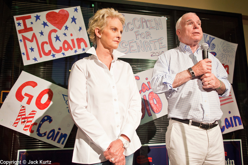 Aug. 23, PHOENIX, AZ: CINDY McCAIN and her husband, US Sen. JOHN McCAIN, at an election rally for Sen McCain at his campaign offices in Phoenix, AZ, Monday. US Sen. John McCain held the final of his primary election campaign at his campaign offices in Phoenix Monday. McCain, Arizona's senior Republican US Senator, is facing former Congressman JD Hayworth in the primary, Tuesday, Aug. 24. McCain has outspent Hayworth by a considerable margin and is expected to win.   Photo by Jack Kurtz