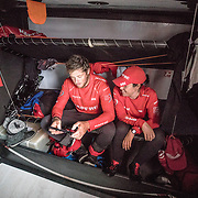 Leg 02, Lisbon to Cape Town, day 14, on board MAPFRE, Antonio Cuervas-Mons y Tamara Echegoyen looking pictures. Photo by Ugo Fonolla/Volvo Ocean Race. 18 November, 2017