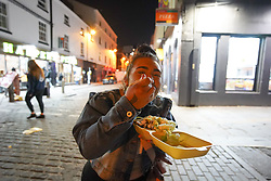© Licensed to London News Pictures. 17/04/2021. Liverpool, UK. A revellers enjoys her food during the first weekend in Liverpool city centre after lockdown restrictions were eased Photo credit:  Ioannis Alexopoulos/LNP