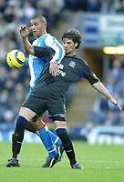 Fotball<br /> Premier League England 2004/2005<br /> 18.12.2004<br /> Foto: SBI/Digitalsport<br /> NORWAY ONLY<br /> <br /> Blackburn v Everton<br /> Barclays Premiership. 18/12/2004. <br /> <br /> Jay Bothroyd of Blackburn Rovers tangles with Alessandro Pistone of Everton.