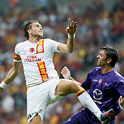 Galatasaray's Johan Elmander (L) and ACF Fiorentina's during their friendly soccer match Galatasaray between ACF Fiorentina at the TT Arena in istanbul Turkey on Wednesday 08 August 2012. Photo by TURKPIX