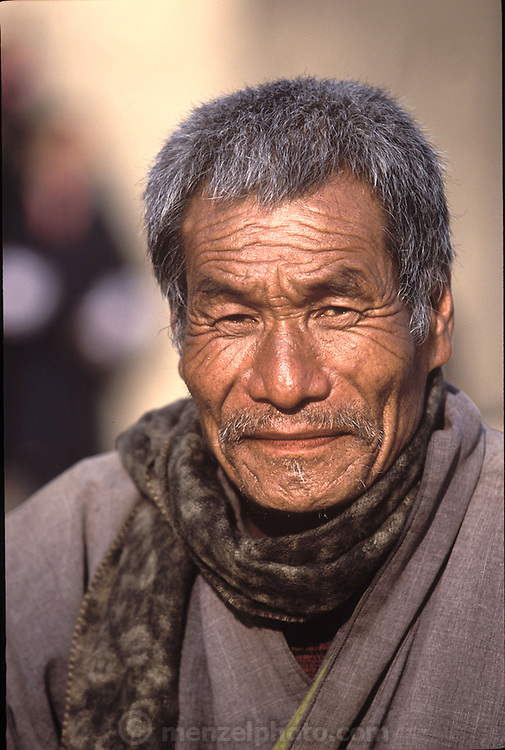 (MODEL RELEASED IMAGE). Namgay, 57, family patriarch and husband of Nalim. (Supporting image from the project Hungry Planet: What the World Eats.) The Namgay family living in the remote mountain village of Shingkhey, Bhutan, is one of the thirty families featured, with a weeks' worth of food, in the book Hungry Planet: What the World Eats.