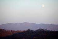 Salisbury Mills, New York - An almost full moon rises above the Hudson Highlands on Nov. 20, 2010.
