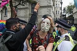 London, UK. 3rd September, 2020. Extinction Rebellion co-founder Dr Gail Bradbrook joins fellow climate activists at a 'Carnival of Corruption' protest outside Downing Street against the government's facilitation and funding of the fossil fuel industry. Extinction Rebellion activists are attending a series of September Rebellion protests around the UK to call on politicians to back the Climate and Ecological Emergency Bill (CEE Bill) which requires, among other measures, a serious plan to deal with the UK's share of emissions and to halt critical rises in global temperatures and for ordinary people to be involved in future environmental planning by means of a Citizens' Assembly.
