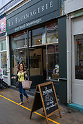 A lady walks out of La Fauxmagerie, a plant-based cheesemonger, in Brixton Village on the 23rd May 2019 in London in the United Kingdom.