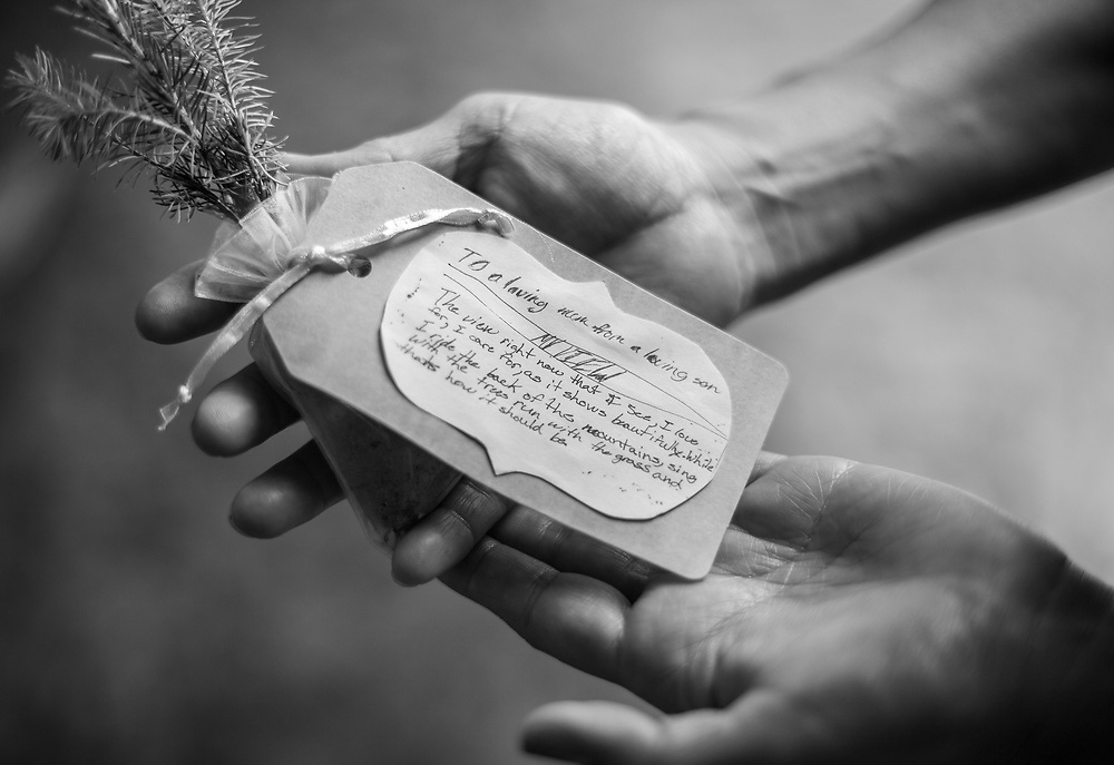 Tree saplings handed out at the memorial were adorned with a copy of a note Nikko wrote his mother when he was a child.