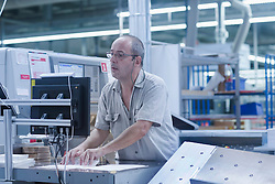 Mature man working in books printing industry, Bremgarten, Hartheim am Rhein, Baden-W¸rttemberg, Germany