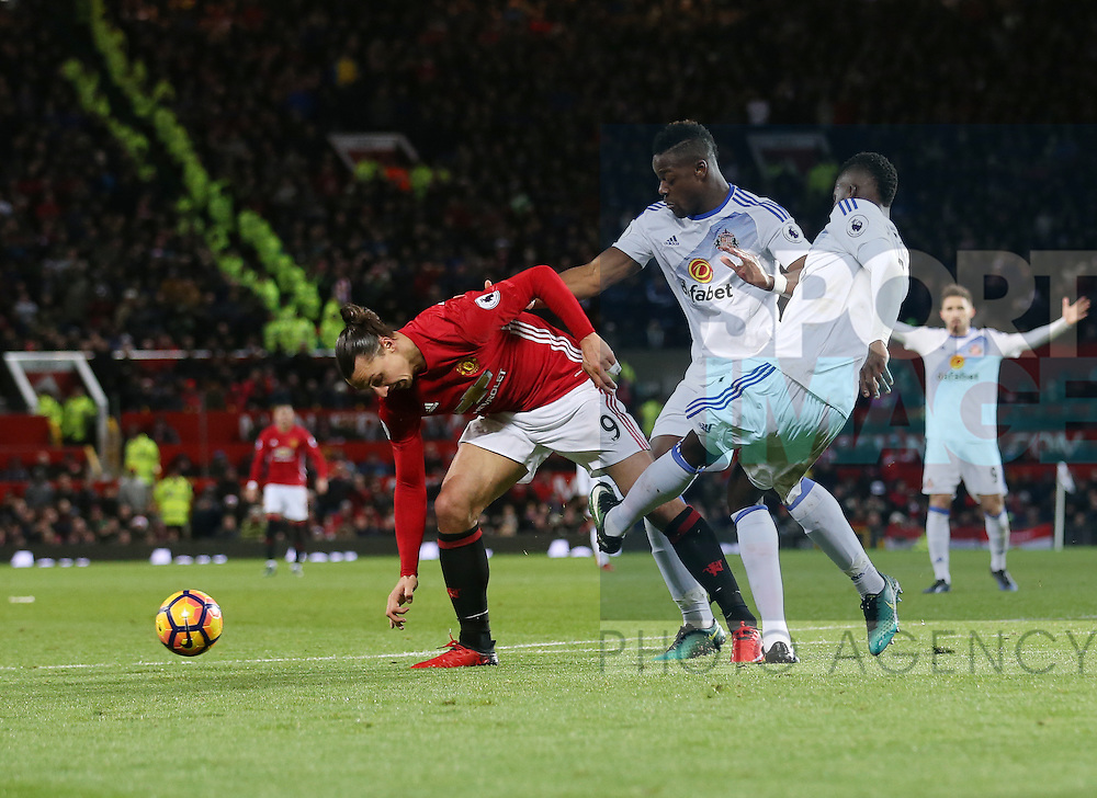 Manchester United's Zlatan Ibrahimovic gets caught by Sunderland's Papy Dijlobodji but no penalty is given during the Premier League match at Old Trafford Stadium, London. Picture date December 26th, 2016 Pic David Klein/Sportimage