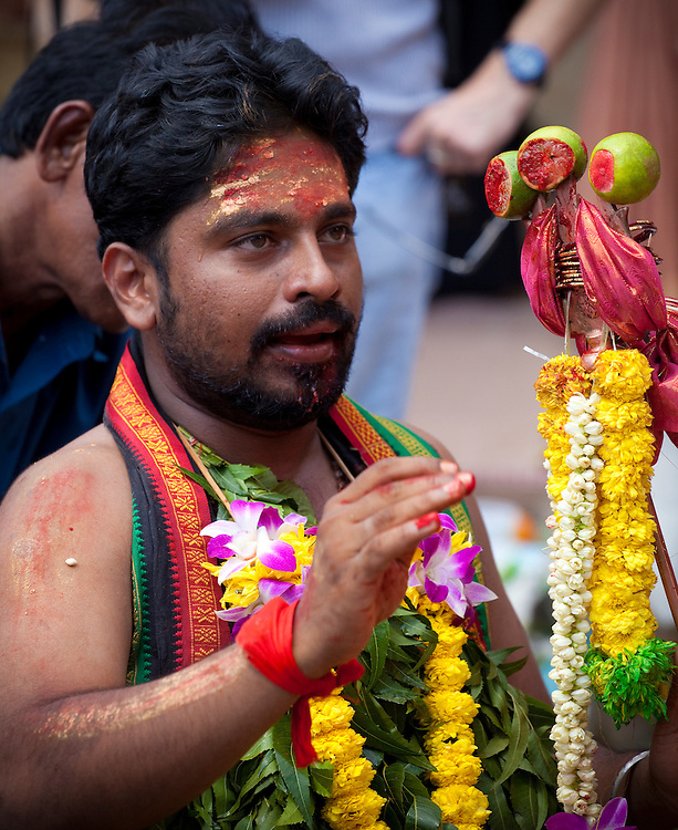 A devout pilgrim in a trance at Thaipusam Festival, Batu Caves, Malaysia. Thaipusam is a Hindu festival celebrated mostly by the Tamil community on the full moon in the Tamil month of Thai (Jan/Feb). The festival celebrates the birth of Murugan,the youngest son of Shiva and his wife Parvati. The festival at Batu Caves, Kuala Lumpur culminates in a 272 step climb into the cave.