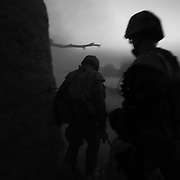Canadian soldiers walk through smoke and dust at dusk after blasting an insurgent weapons cache in the Sperwan area of Panjwai District, Kandahar Province, Afghanistan. Canadian soldiers have suffered one of the highest casualty rates of any western army battling insurgents in one of the most violent regions of the country.