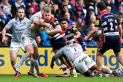 Mitch Eadie of Bristol Rugby is tackled by Ross Batty and Beno Obano of Bath Rugby - Rogan Thomson/JMP - 26/02/2017 - RUGBY UNION - Ashton Gate Stadium - Bristol, England - Bristol Rugby v Bath - Aviva Premiership.