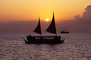 Catamaran at sunset, Waikiki, Oahu, Hawaii<br />