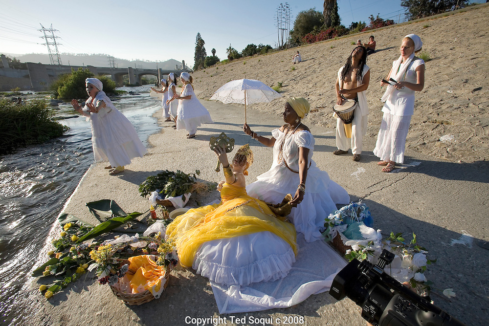 LA River expedition day two in the Glendale Narrows area..River dancers sing and bless the LA River expedition as they pass by.