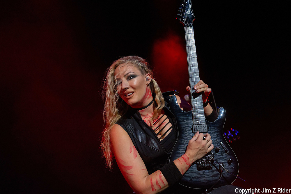 NITA STRAUSS, vocals and guitar, performs with Alice Cooper.  After nearly 19 months off stage, Rock and Roll legend Alice Cooper, 73, launched his fall 2021 tour at Ocean Casino Resort in Atlantic City, New Jersey.