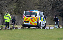 © Licensed to London News Pictures. 01/04/2020. London, UK. Police stop a women with children on a bike (children can cycle but adults can't) as mounted police patrol Richmond Park in South West London to keep a firm check on social distancing rules as the Coronavirus crisis continues. Photo credit: Alex Lentati/LNP
