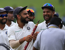 August 14, 2017 - Colombo, Sri Lanka - Indian cricket captain and his team walk back to the pavilion after winning the 3rd Test during the 3rd Day's play in the 3rd and final Test match between Sri Lanka and India at the Pallekele international cricket stadium at Kandy, Sri Lanka on MOnday 14 August 2017. (Credit Image: © Tharaka Basnayaka/NurPhoto via ZUMA Press)