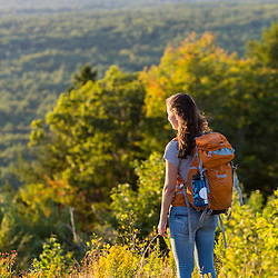 A girl enjoys the view from the summit of Mount Agamenticus in York, Maine.
