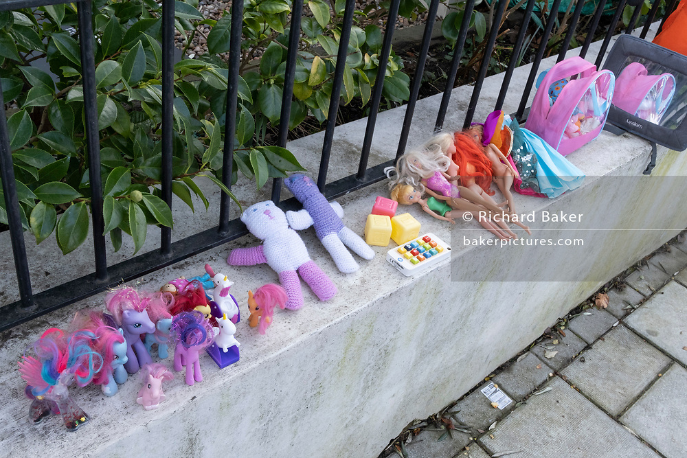 The discarded possessions of a young girl, part of a winter's decluttering, consists of My Little Ponies and Barbie Dolls, which are lined-up on a wall outside a residential home in Herne Hill, south London, on 23rd January 2021, in London, England.