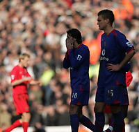 Photo: Lee Earle.<br /> Liverpool v Manchester United. The FA Cup. 18/02/2006. United's Ruud van Nistelrooy (L) and Nemanja Vidic look dejected after losing to Liverpool.