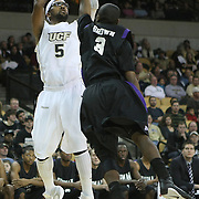 Central Florida guard Marcus Jordan (5) shoots the ball against Furman guard Richard Brown (3) during an NCAA basketball game at the UCF Holiday Classic at the UCF Arena on December 29, 2010 in Orlando, Florida. (AP Photo/Alex Menendez)