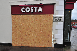 © Licensed to London News Pictures. 26/12/2015<br /> Boarded up side window the car crashed into.<br /> Flowers at the Costa coffee shop in Westerham in Kent. A 70 year old lady was killed here on Christmas eve after an Audi car crash into the shop.<br /> (Byline:Grant Falvey/LNP)