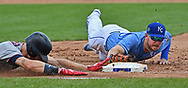 Kansas City Royals first baseman Ryan O'Hearn (66) makes a diving tag at first base, to force out Minnesota Twins center fielder Max Kepler (left) during the fourth inning at Kauffman Stadium.