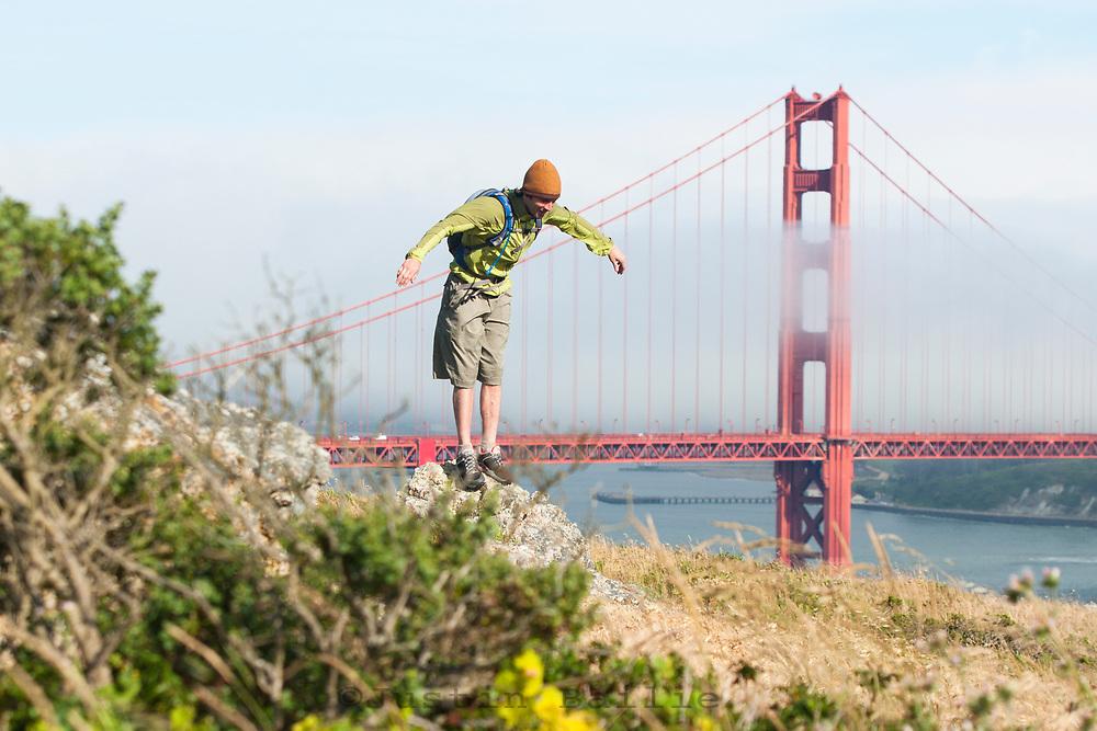 Young man hiking the Marin Headlands, Golden Gate National Recreation Area. San Francisco,  CA