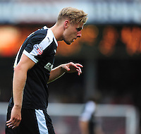 Barnsley's Marc Roberts is forced off for treatment with blood dripping from his face<br /> <br /> Photographer Chris Vaughan/CameraSport<br /> <br /> Football - Capital One Cup First Round - Scunthorpe United v Barnsley - Tuesday 11th August 2015 - Glanford Park - Scunthorpe<br />  <br /> © CameraSport - 43 Linden Ave. Countesthorpe. Leicester. England. LE8 5PG - Tel: +44 (0) 116 277 4147 - admin@camerasport.com - www.camerasport.com