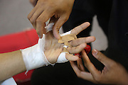 """Hands bandaged before fight<br /><br />MMA. Mixed Martial Arts """"Tigers of Asia"""" cage fighting competition. Top professional male and female fighters from across Asia, Russia, Australia, Malaysia, Japan and the Philippines come together to fight. This tournament takes place in front of a ten thousand strong crowd of supporters in Pelaing Stadium. Kuala Lumpur, Malaysia. October 2015"""